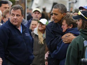 President Barack Obama hugs North Point Marina owner Donna Vanzant as he tours the damage in Brigantine-N.J-nader-nazemi